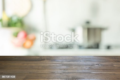 607472174istockphoto Blurred background. Modern kitchen with tabletop and space for you. 867081408
