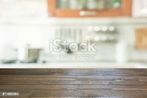 607472174istockphoto Blurred background. Modern kitchen with tabletop and space for you. 871885984