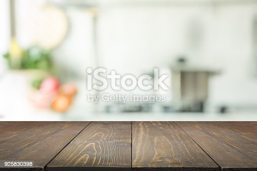 istock Blurred background. Modern kitchen with tabletop and space for you. 925830398