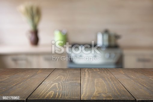 istock Blurred background. Modern kitchen with tabletop and space for you. 932175952