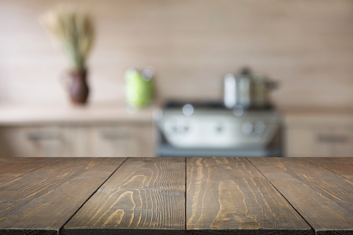 Blurred abstract background. Modern kitchen with tabletop and space for you.