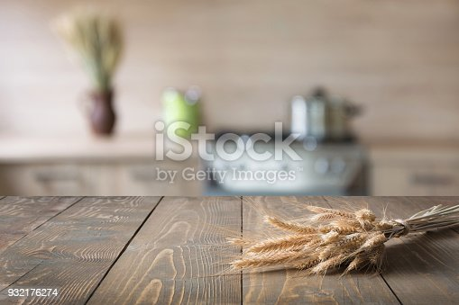 607472268 istock photo Blurred background. Modern kitchen with tabletop and space for you. 932176274
