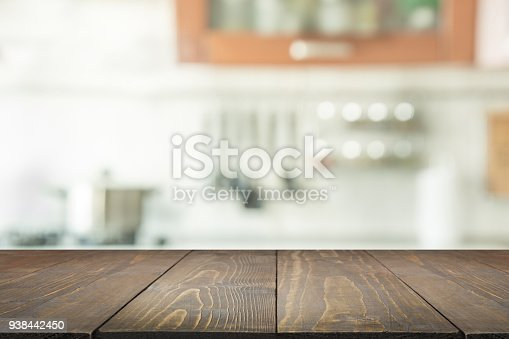istock Blurred background. Modern kitchen with tabletop and space for you. 938442450