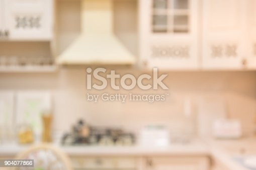 istock Blurred background. Modern pastel kitchen with bokeh light. 904077866