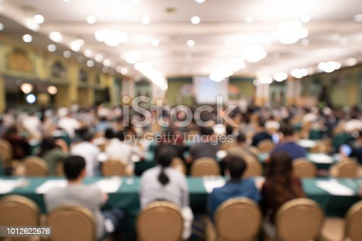 Blurred background of audience in the conference hall or seminar