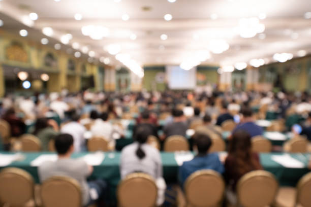 blurred background of audience in the conference hall or seminar - seminario riunione foto e immagini stock