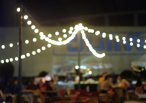 Abstract blurred background of beer garden festival at night with bokeh.