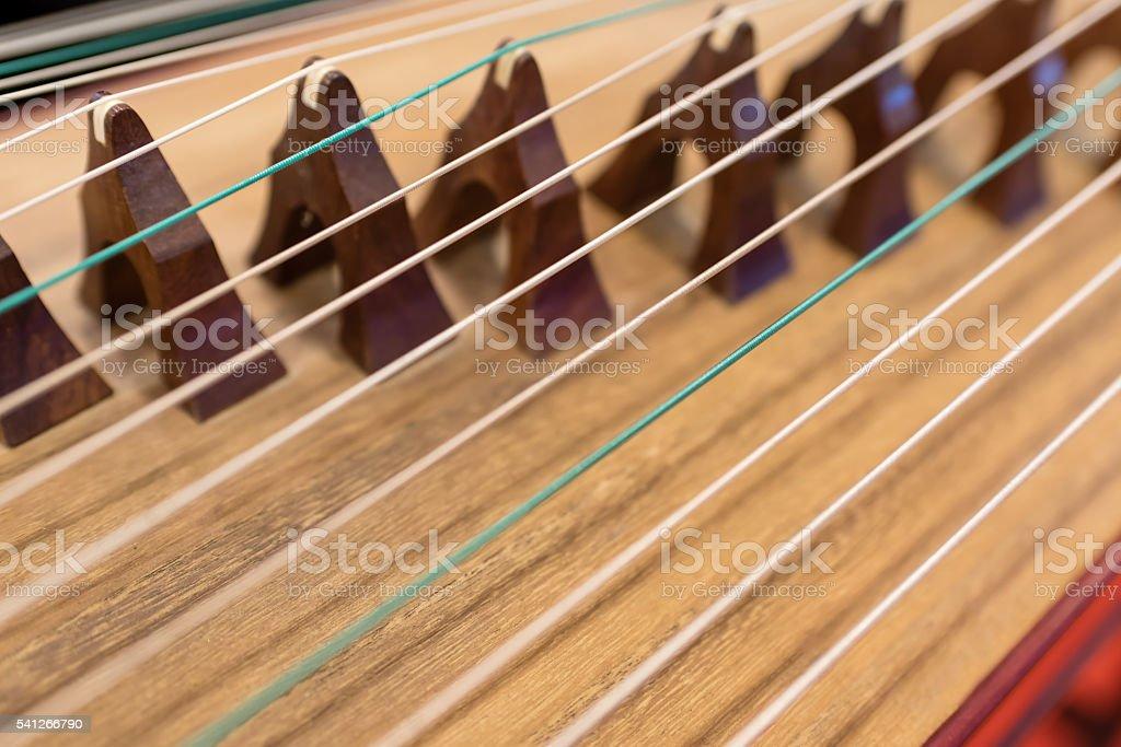 blurred background of Chinese folk music instrument (guzheng) stock photo