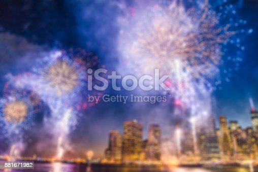 istock Blurred background of cityscape with beautiful fireworks at night, Manhattan, New York City 881671982