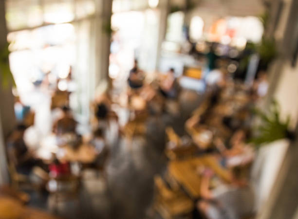 Blurred background of coworking place in coffee cafe stock photo
