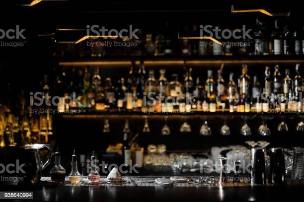 Blurred background of dark bar with barman essentials picture id938640994?b=1&k=6&m=938640994&s=612x612&h= x5rtcr0jj7cmzmpne umo3w6jukivdrxwqbsvmi9kq=