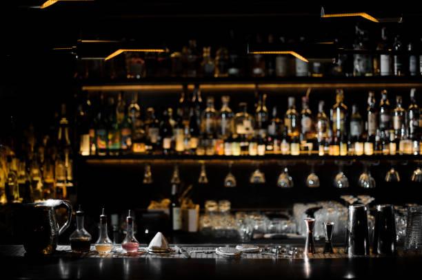 Blurred background of dark bar with barman essentials picture id938640994?b=1&k=6&m=938640994&s=612x612&w=0&h=5s3ynpzaybndzf9a zsxqzs9etynwdkgu58kxqax2qa=