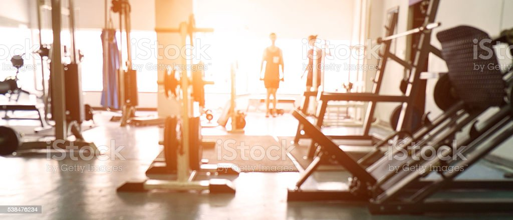 Blurred background of gym. - Foto stock royalty-free di Acciaio