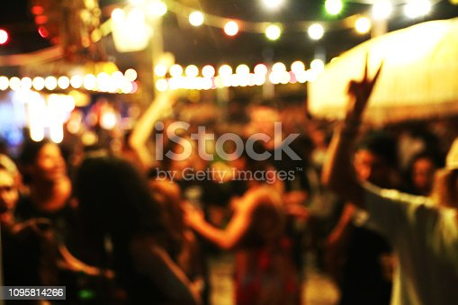 860440036 istock photo Blurred background of many people had fun at a beach party 1095814266