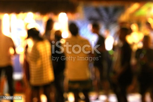 860440036 istock photo Blurred background of many people had fun at a beach party 1095814326