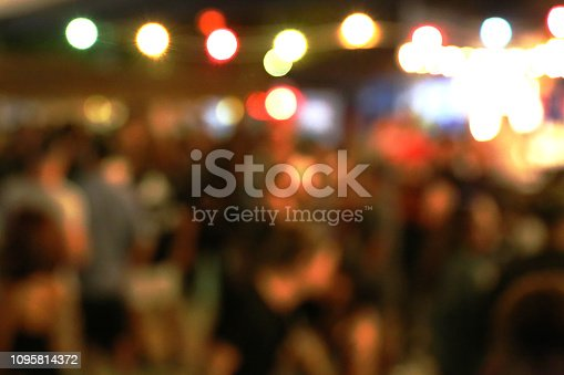 860440036 istock photo Blurred background of many people had fun at a beach party 1095814372