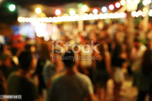 860440036 istock photo Blurred background of many people had fun at a beach party 1095814412