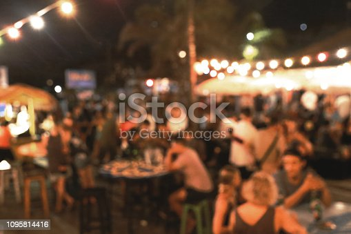 860440036 istock photo Blurred background of many people had fun at a beach party 1095814416