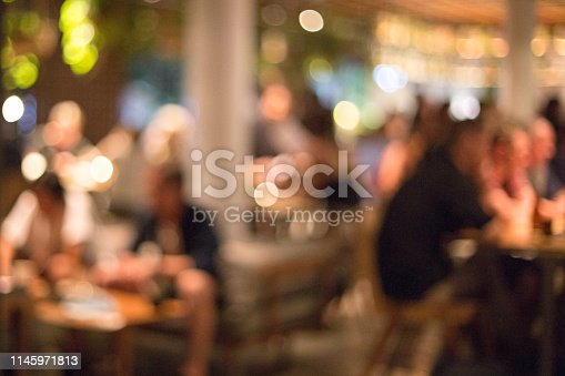 613897214istockphoto Blurred background of many people had fun at a beach party. 1145971813