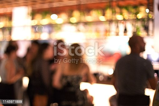 613897214istockphoto Blurred background of many people had fun at a beach party. 1145971859