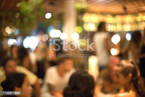 613897214istockphoto Blurred background of many people had fun at a beach party. 1145971862