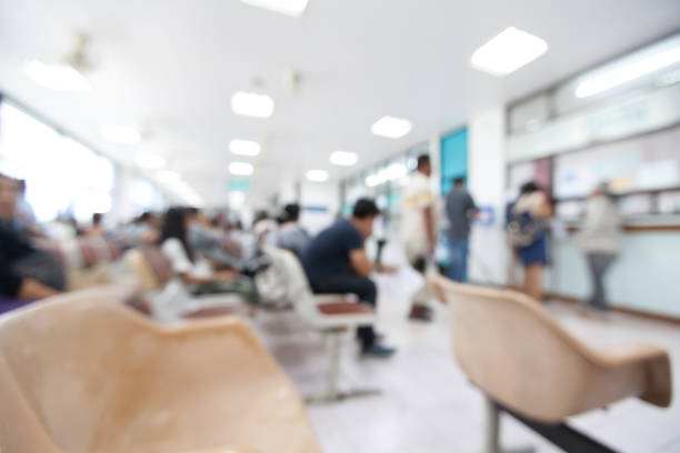 blurred background of patient waiting for see doctor in the hospital. - hospital stock pictures, royalty-free photos & images