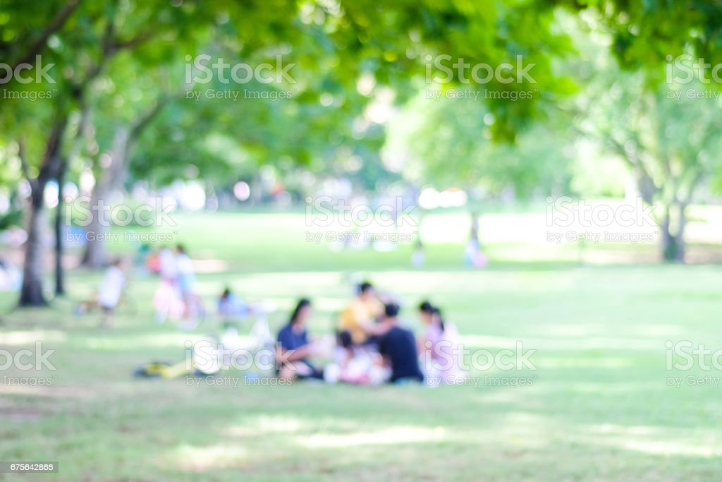 Blurred background of people activities in park with bokeh light, spring and summer royalty-free stock photo