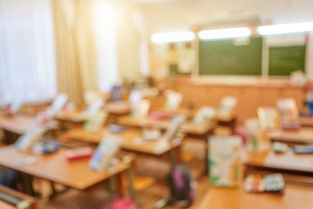 Blurred background of school class without students. Concept of evacuation and rescue of children in case of alarm or fire stock photo