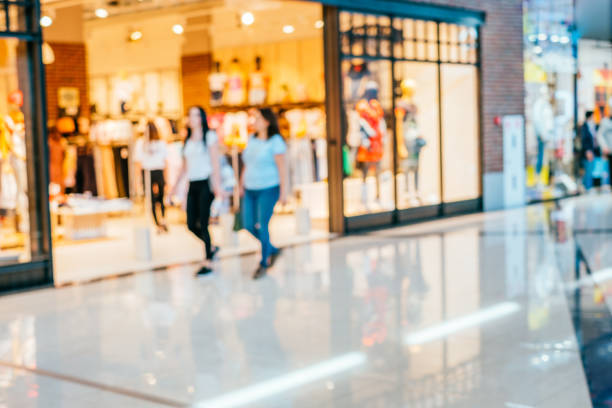blurred background of shopping mall - shopping mall stock photos and pictures