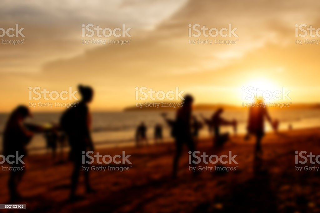 Blurred background of silhouette people on beach when sunset tine stock photo