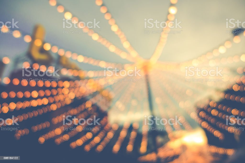 blurred background of string light bulb and blue sky background stock photo