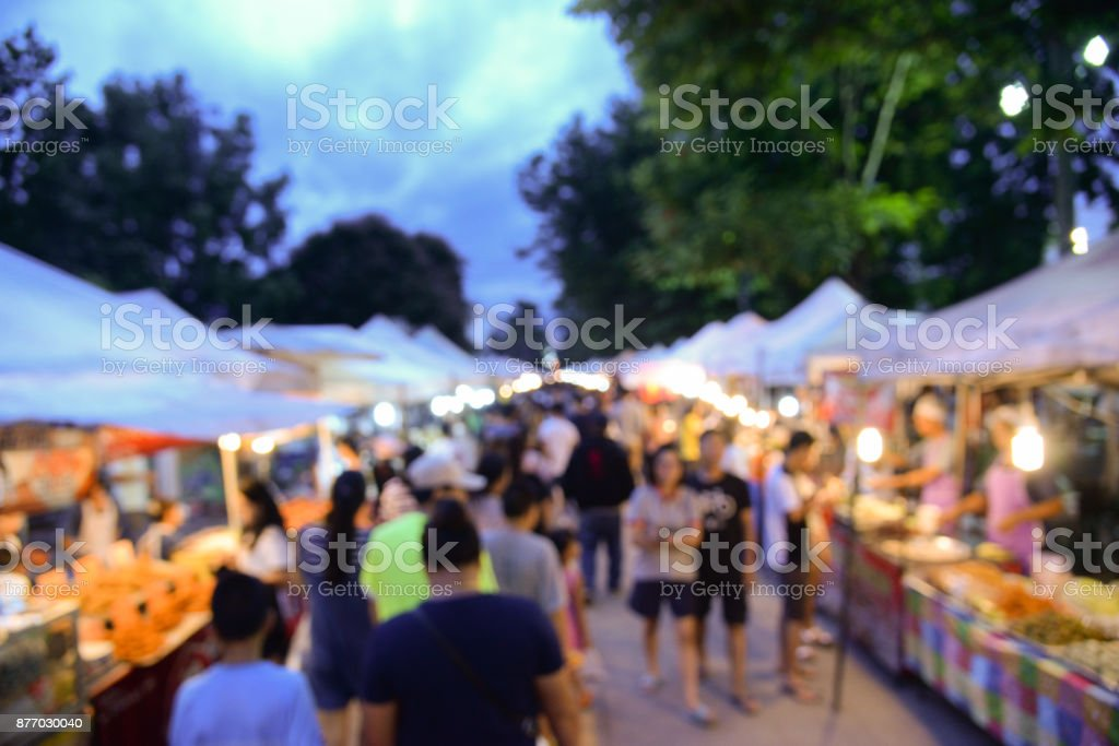 Blurred background of walking street market in bangkok thailand.Tourist walking at local street market for shopping in weekend stock photo