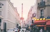 Blurred background. Parisian street with Eiffel Tower in perspective (France)