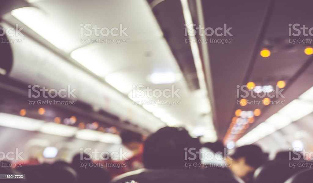 Blurred background : passenger on airplane stock photo