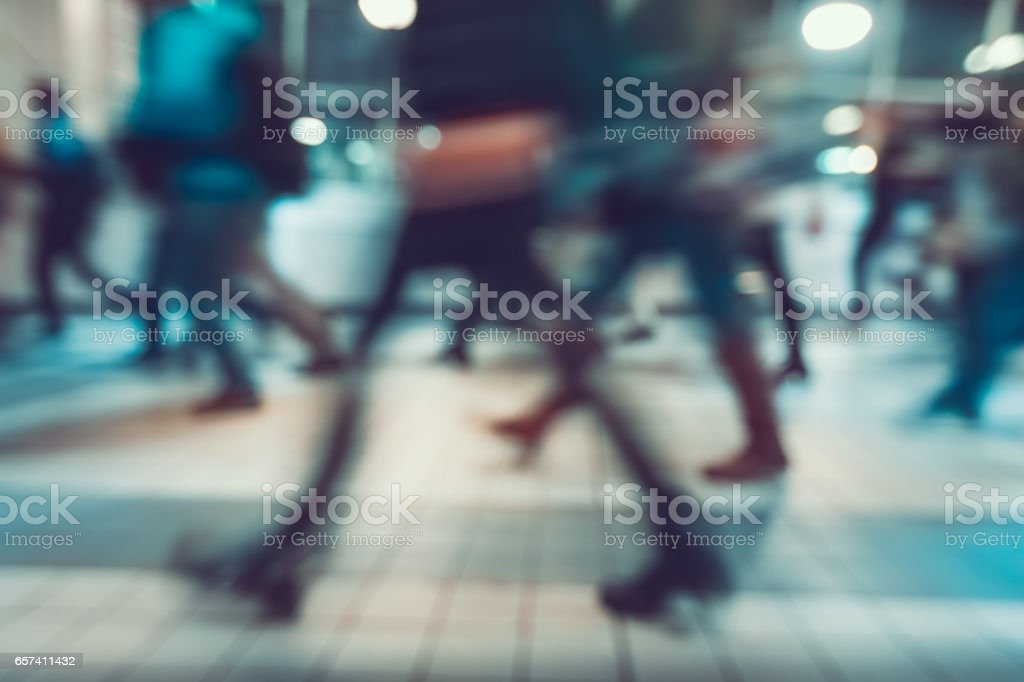 Blurred background. Pedestrians hurrying to transport stock photo