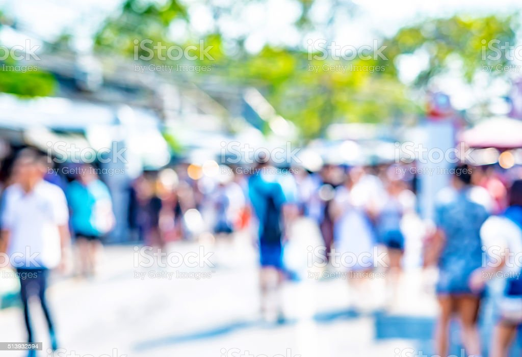 Blurred background : people shopping at market fair in day stock photo