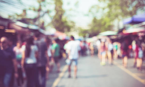 blurred background : people shopping at market fair - traditional festival stock photos and pictures