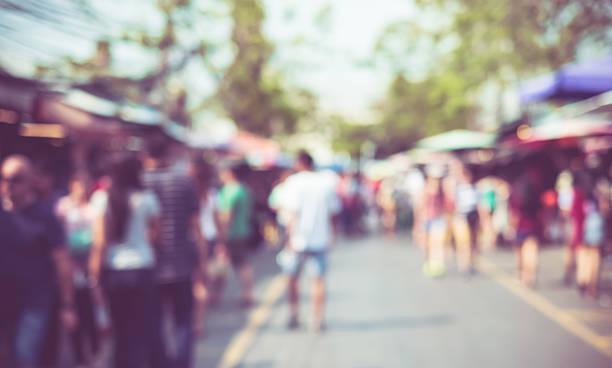 blurred background : people shopping at market fair - traditioneel festival stockfoto's en -beelden
