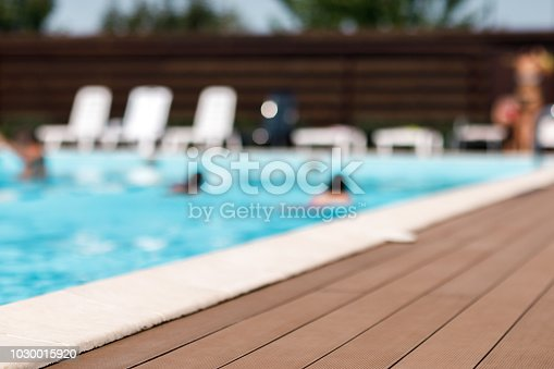 summer background. blurred background Swimming pool in summer sunny day. selective focus on the foreground on the floor