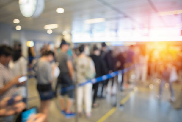 blurred background queue. - airport stock photos and pictures