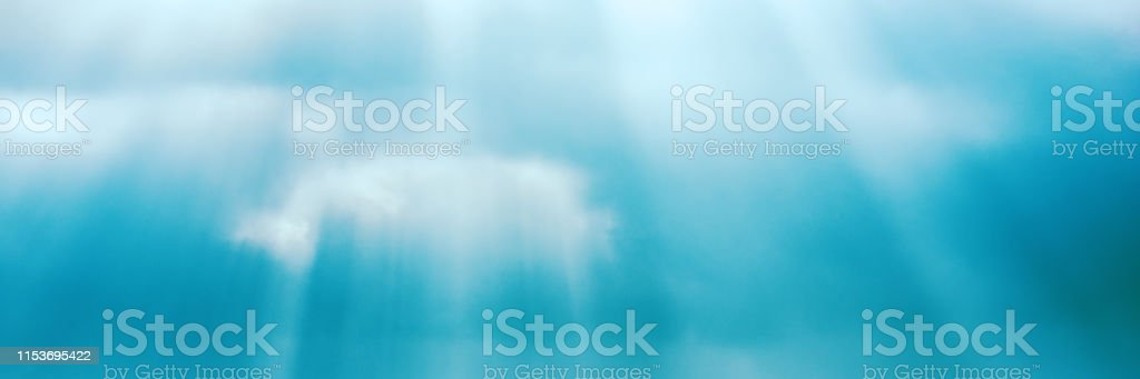 blurred background, rainy sky and bright sunshine on the background...