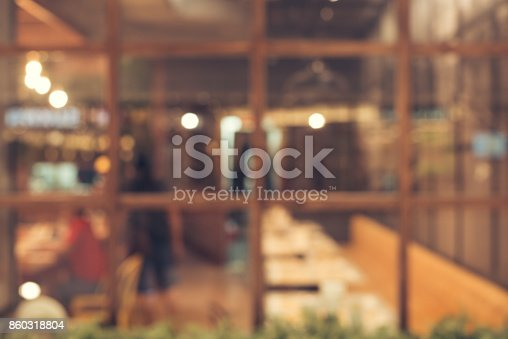 istock Blurred background - Vintage filter Customer in Coffee shop blur background with bokeh. 860318804