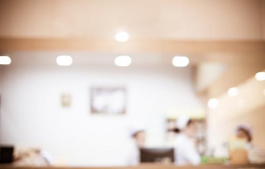 istock Blurred background : Vintage filter nurse at hospital counter 484823634