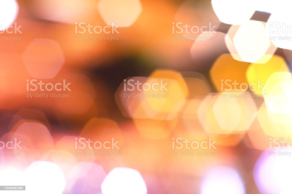 Blurred background with flare lights and light bokeh bubbles, orange and gold color stock photo