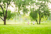 Blurred background,People exercise at green park with bokeh ligh