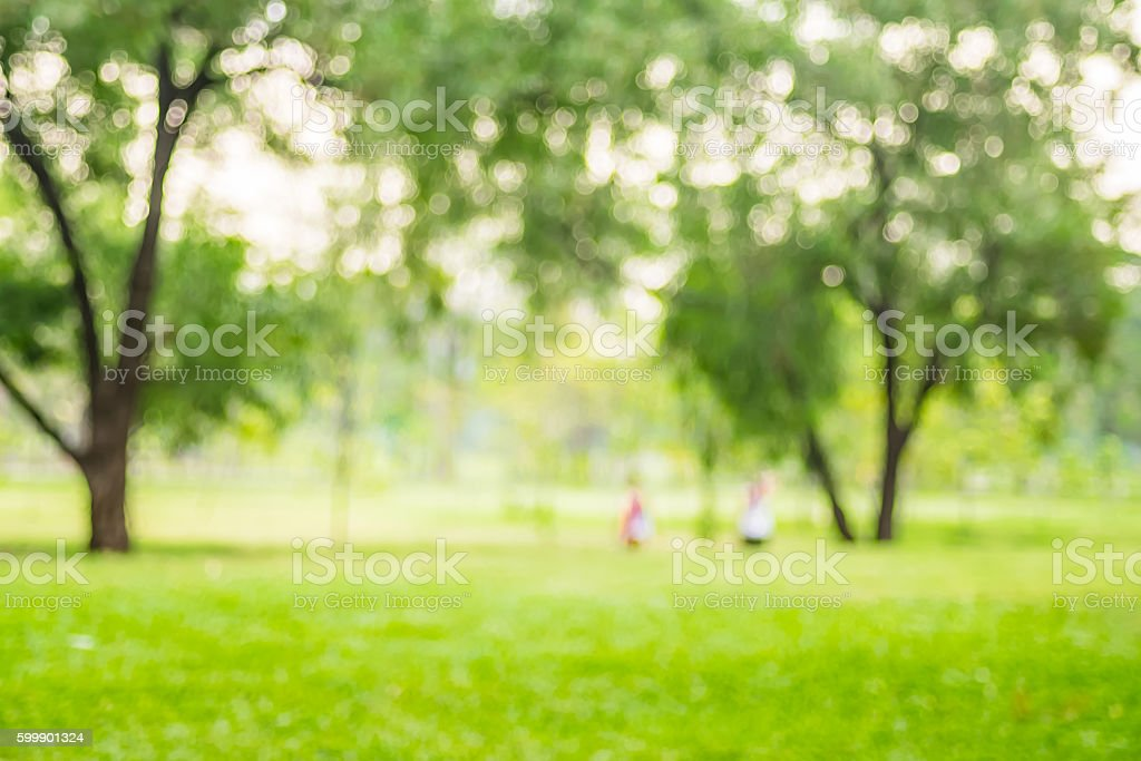 Blurred background,People exercise at green park with bokeh ligh stock photo