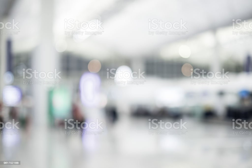 Blurred background,Traveler with baggage at Terminal Departure Check-in at airport with bokeh light,transportation concept stock photo