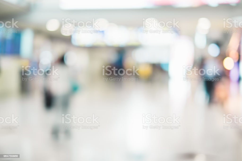 Blurred background,Traveler with baggage at Terminal Departure Check-in at airport with bokeh light,transportation concept. royalty-free stock photo