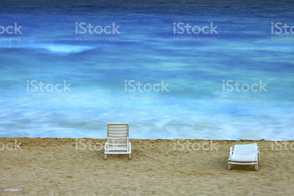 Blurred beach and chair at sunset, Caribbean royalty-free stock photo