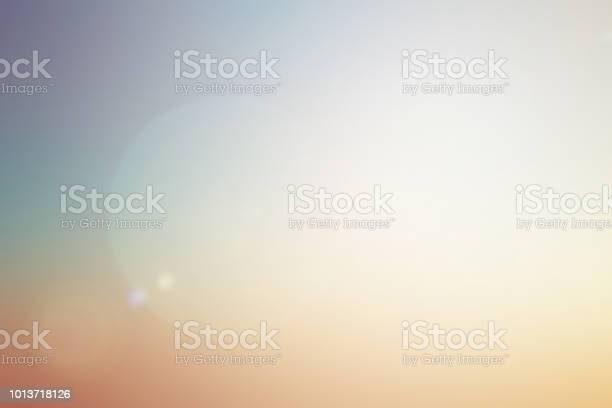 Photo of blurred beautiful natural pastel background lens ray flare flash light.